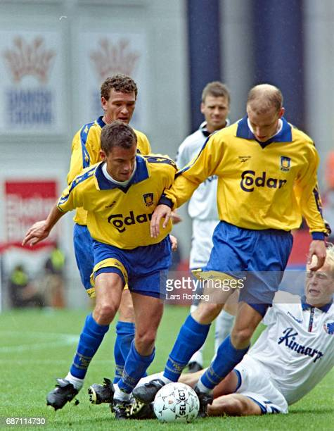 Kenneth Rasmussen John Faxe Jensen and Kim Daugaard of Brondby IF compete for the ball with Thomas Thorninger of FC Copenhagen during the Danish Cup...