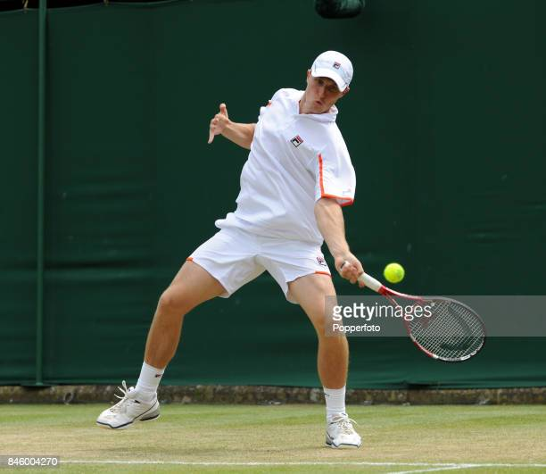 Kenneth Skupski of Great Britain in doubles action on Day Six of the Wimbledon Lawn Tennis Championships at the All England Lawn Tennis and Croquet...