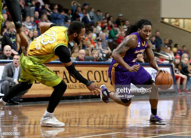 Kenneth Smith from the Los Angeles DFenders drives to the basket past Jabril Trawick from the Sioux Falls Skyforce at the Sanford Pentagon March 18...