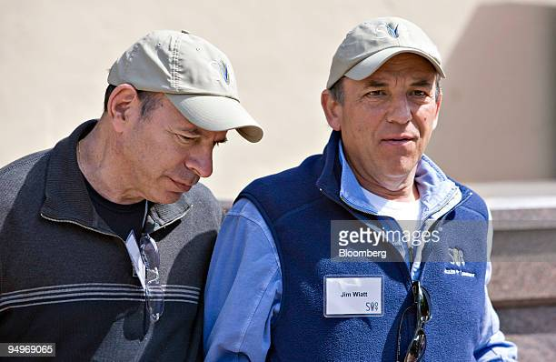Kenneth Starr chairman and chief executive officer of Starr Co left walks with James Wiatt chairman of the William Morris Agency during the Allen Co...