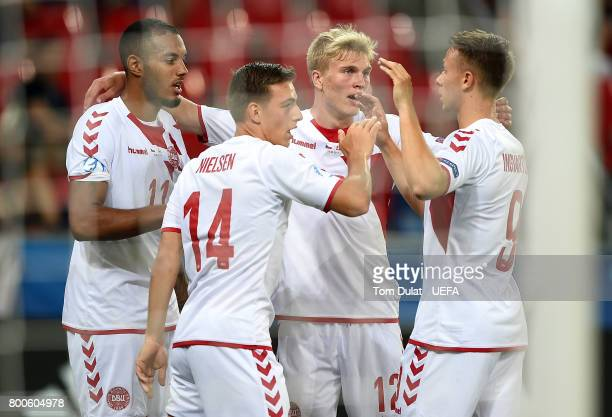 Kenneth Zohore of Denmark celebrates with the team scoring his sides third goal during the UEFA European Under21 Championship Group C match between...