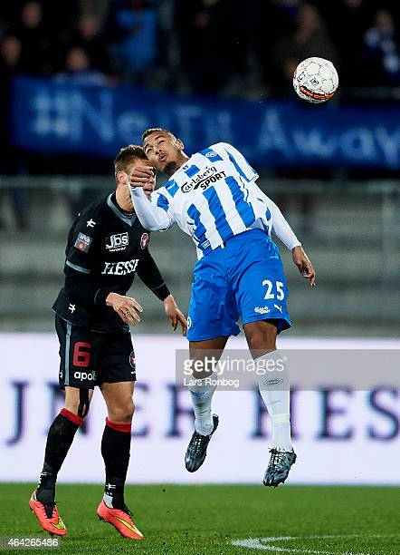 Kenneth Zohore of OB Odense and Jim Larsen of FC Midtjylland compete for the ball during the Danish Alka Superliga match between FC Midtjylland and...