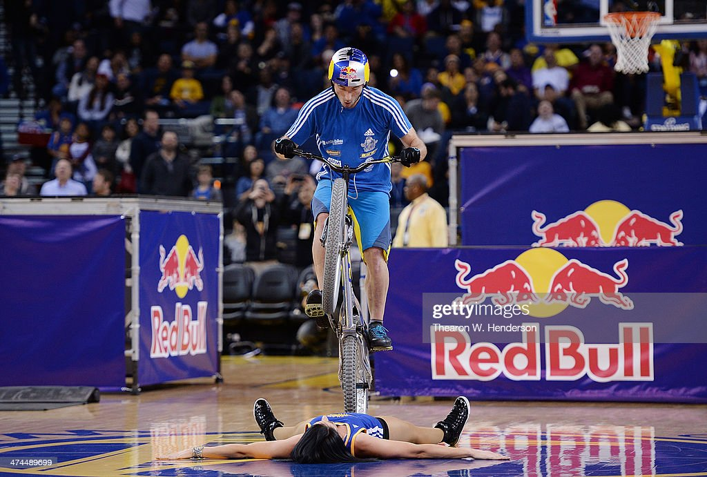 Kenney Belaey nick name 'The Magician' and sponsored by Red Bull does bike tricks during half time of an NBA Basketball game between the Houston...