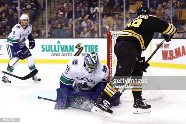 Kenny Agostino of the Boston Bruins takes a shot against Anders Nilsson of the Vancouver Canucks during the first period at TD Garden on October 19...