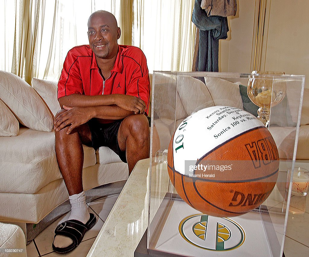 Kenny Anderson, a former NBA All-Star guard, sits in his living room with his '10,000' trophy ball from when he was with the Seattle Sonics in 2002, during an interview at his home in Pembroke Pines, Florida, April 8, 2010. Anderson, who grew up in Brooklyn, became a big star, but lost a lot of the money he earned as an NBA player.