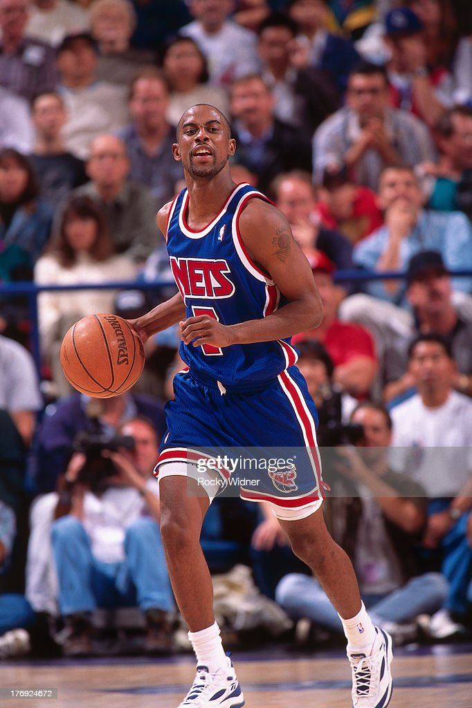 Kenny Anderson #7 of the New Jersey Nets dribbles the ball against the Sacramento Kings on November 23, 1994 at Arco Arena in Sacramento, California.