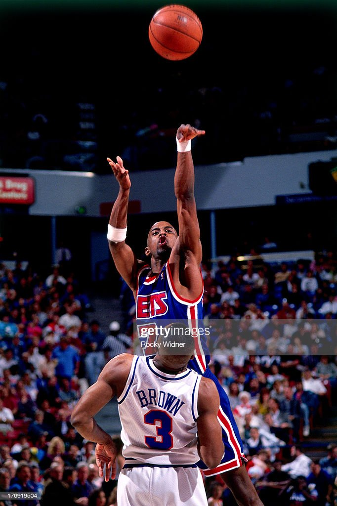 <a gi-track='captionPersonalityLinkClicked' href=/galleries/search?phrase=Kenny+Anderson+-+Basketballer&family=editorial&specificpeople=202155 ng-click='$event.stopPropagation()'>Kenny Anderson</a> #7 of the New Jersey Nets shoots the ball against the Sacramento Kingsduring a game played on March 16, 1994 at Arco Arena in Sacramento, California.