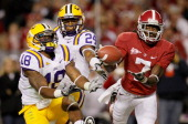 Kenny Bell of the Alabama Crimson Tide fails to pull in his touchdown attempt against Brandon Taylor and Tharold Simon of the LSU Tigers at...