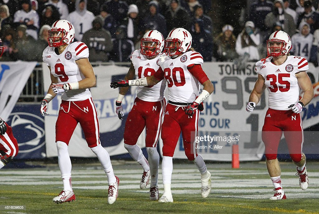 Kenny Bell #80 of the Nebraska Cornhuskers celebrates after running back a kick off 99 yards for a touchdown against the Penn State Nittany Lions during the game on November 23, 2013 at Beaver Stadium in State College, Pennsylvania.