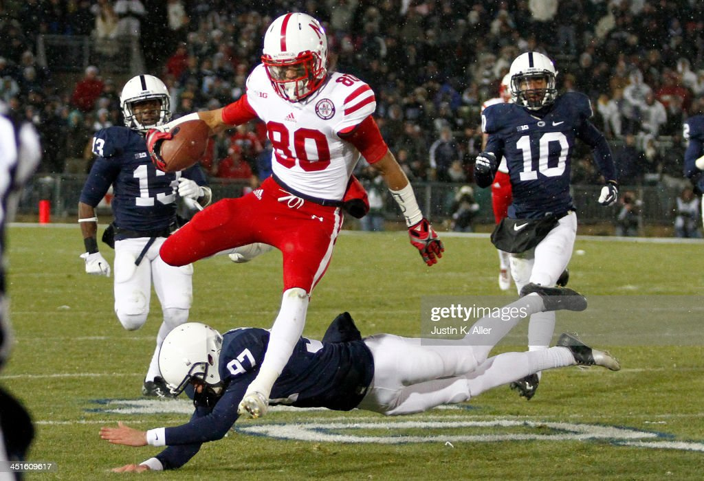Kenny Bell #80 of the Nebraska Cornhuskers runs back a kick off 99 yards for a touchdown against the Penn State Nittany Lions during the game on November 23, 2013 at Beaver Stadium in State College, Pennsylvania.