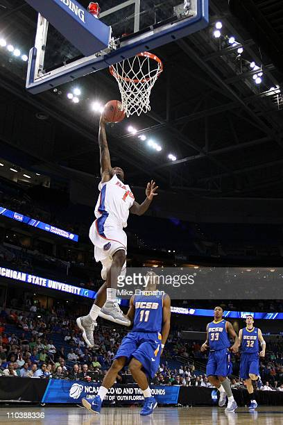 Kenny Boynton of the Florida Gators drives for a shot attempt against Justin Joyner of the UC Santa Barbara Gauchos during the second round of the...