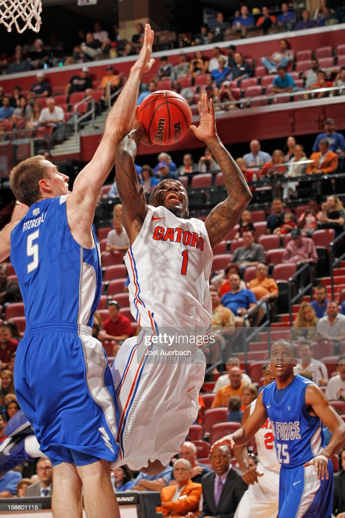 Kenny Boynton #1 of the Florida Gators goes to the basket against Mike Fitzgerald #5 of the Air Force Falcons at the MetroPCS Orange Bowl Basketball Classic on December 29, 2012 at the BB&T Center in Sunrise, Florida.