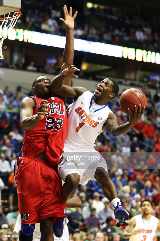 Kenny Boynton #1 of the Florida Gators goes up against Reginald Buckner #23 of the Ole Miss Rebels in the second half of the SEC Basketball Tournament Championship game at Bridgestone Arena on March 17, 2013 in Nashville, Tennessee.