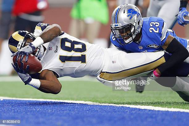 Kenny Britt of the Los Angeles Rams stretches out over the goal line for at touchdown against the defense of Darius Slay of the Detroit Lions during...