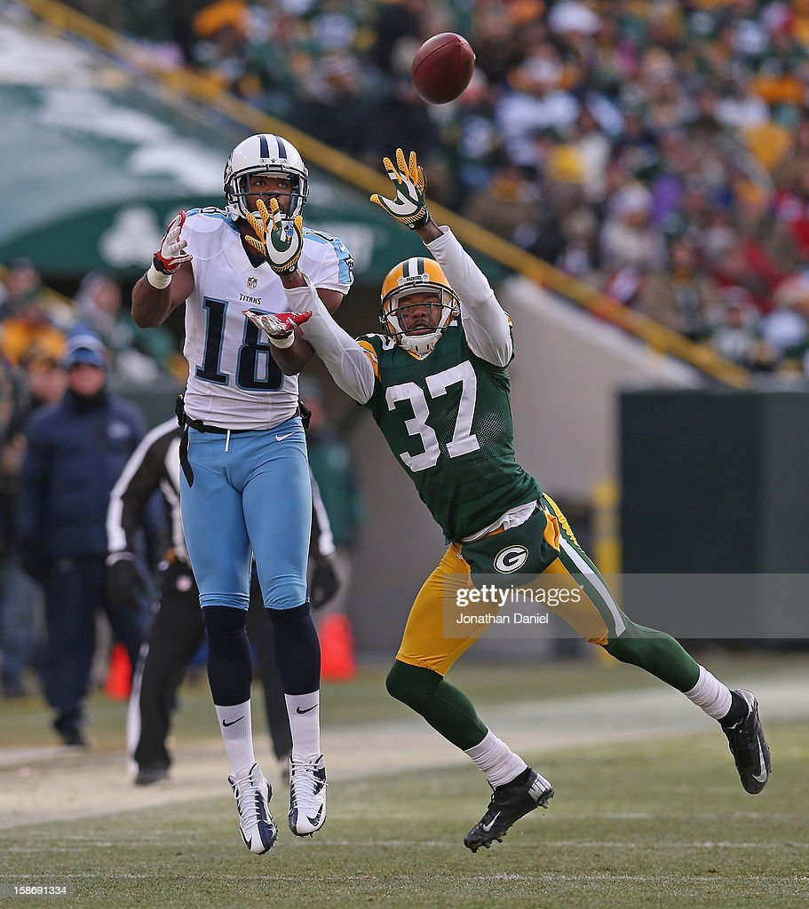 <a gi-track='captionPersonalityLinkClicked' href=/galleries/search?phrase=Kenny+Britt&family=editorial&specificpeople=469830 ng-click='$event.stopPropagation()'>Kenny Britt</a> #18 of the Tennessee Titans leaps to make a catch under pressure from Sam Shields #37 of the Green Bay Packers at Lambeau Field on December 23, 2012 in Green Bay, Wisconsin. The Packers defeated the Titans 55-7.