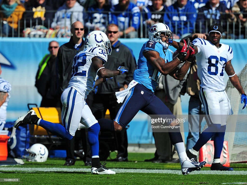 <a gi-track='captionPersonalityLinkClicked' href=/galleries/search?phrase=Kenny+Britt&family=editorial&specificpeople=469830 ng-click='$event.stopPropagation()'>Kenny Britt</a> #18 of the Tennessee Titans makes a catch against Cassius Vaughn #32 of the Indianapolis Colts at LP Field on October 28, 2012 in Nashville, Tennessee.