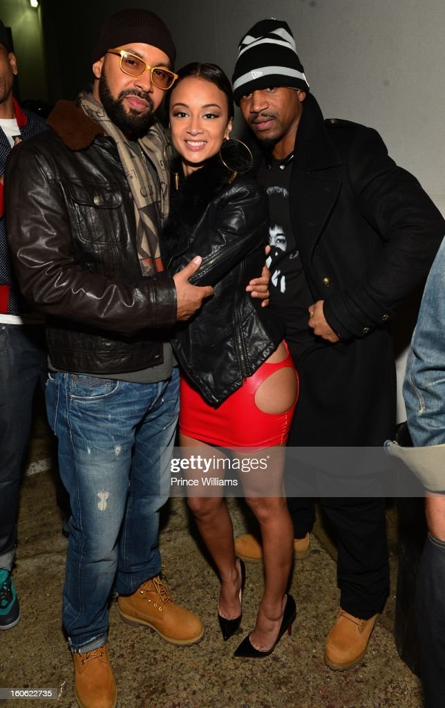 Kenny Burns, Draya Michele and Stevie J attend a party at Compound on February 2, 2013 in Atlanta, Georgia.