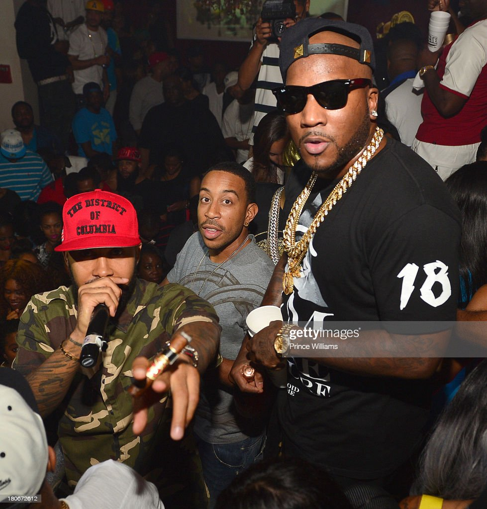 Kenny Burns Ludacris and Young Jeezy attend LudaDay Weekend Finale Celebration at Velvet Nightclub on September 1 2013 in Atlanta Georgia