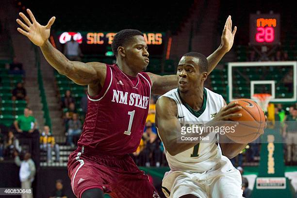 Kenny Chery of the Baylor Bears drives to the basket against DK Eldridge of the New Mexico State Aggies on December 17 2014 at the Ferrell Center in...