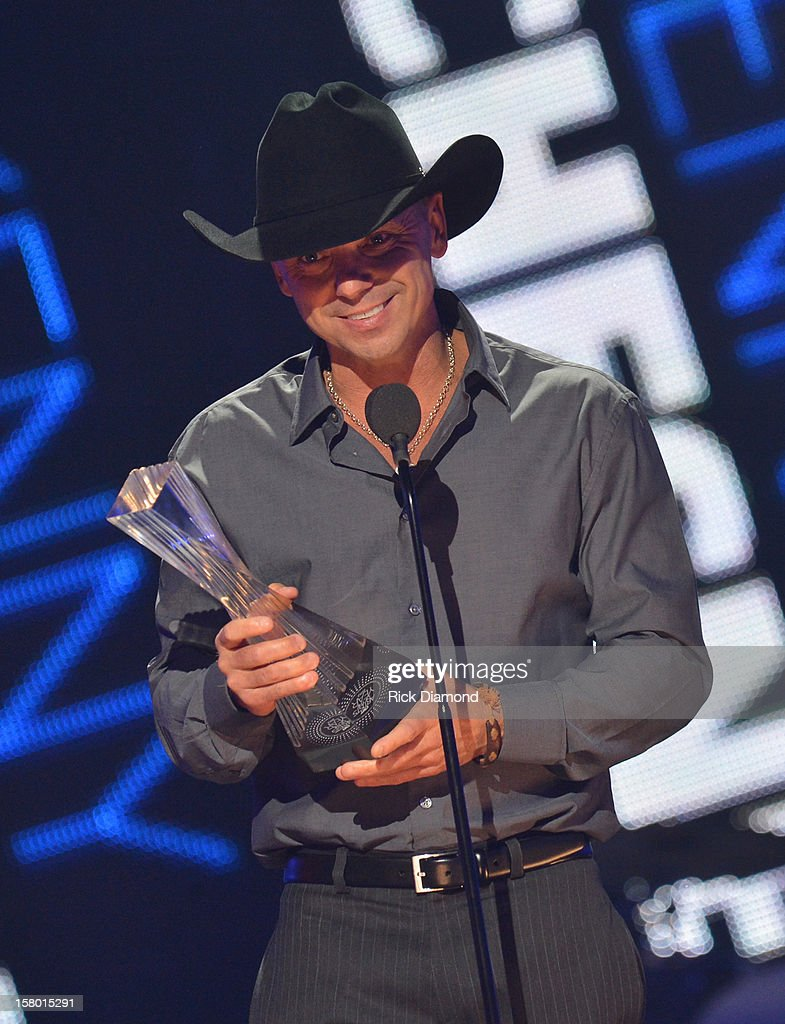 Kenny Chesney accepts award onstage during the 2012 CMT Artists Of The Year at The Factory at Franklin on December 3 2012 in Franklin Tennessee