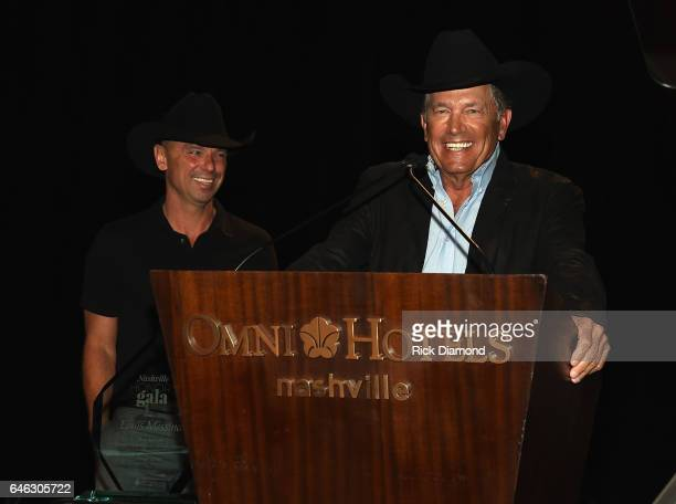 Kenny Chesney and George Strait present Tony Martell Lifetime Entertainment Achievement Award to Louis Messina at the TJ Martell Foundation 9th...