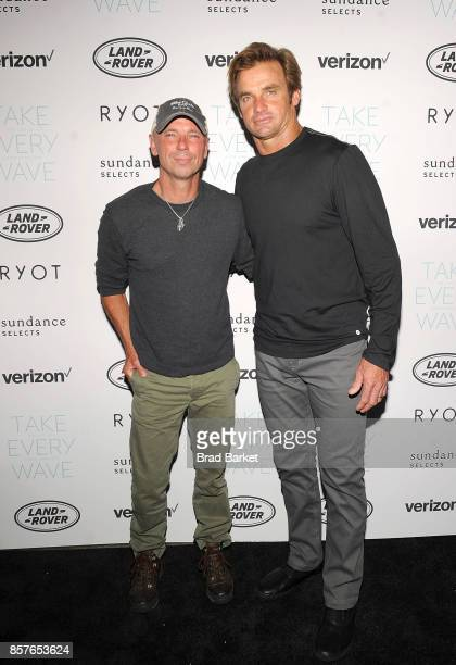 Kenny Chesney and Laird Hamilton attend the 'Take Every Wave The Life Of Laird Hamilton' New York Premiere at The Metrograph on October 4 2017 in New...