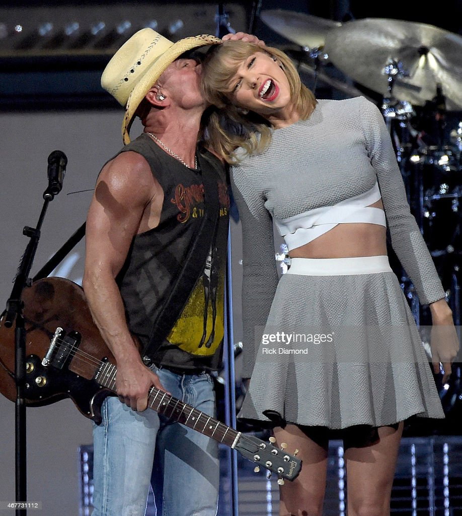 Kenny Chesney and Taylor Swift perform onstage during Kenny Chesney's The Big Revival 2015 Tour kick-off for a 55 show run through August. The high-energy opening night included 2½ hours of music, including five songs from his #1 The Big Revival, surprise guests and a leaner, cleaner stage and 2.3 million pixel screen that gave the sold out house the best view theyve ever had of the 8-time Entertainer of the Year at the Bridgestone Arena on March 26, 2015 in Nashville, Tennessee