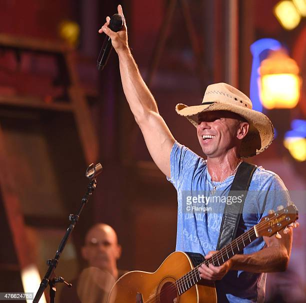 Kenny Chesney performs during the 2015 CMT Music awards at the Bridgestone Arena on June 10 2015 in Nashville Tennessee