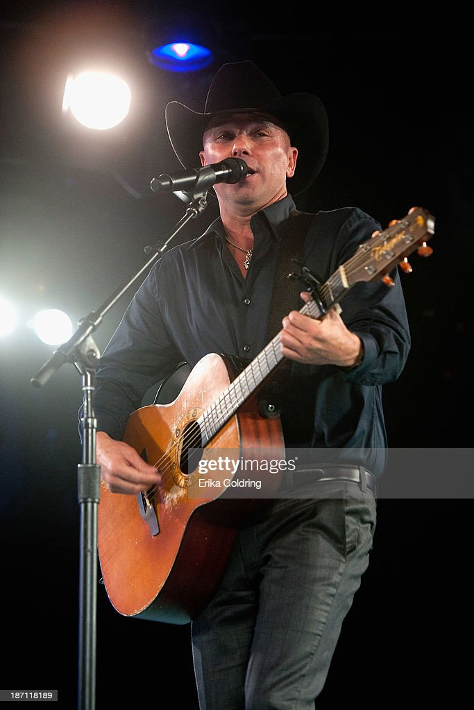 <a gi-track='captionPersonalityLinkClicked' href=/galleries/search?phrase=Kenny+Chesney&family=editorial&specificpeople=209324 ng-click='$event.stopPropagation()'>Kenny Chesney</a> performs during the tribute to BMI 2013 Icon Dean Dillon during the 61st annual BMI Country Awards on November 5, 2013 in Nashville, Tennessee.