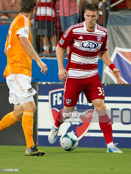 Kenny Cooper of FC Dallas brings the ball up field against Bobby Boswell of Houston Dynamo on June 12 2013 at FC Dallas Stadium in Frisco Texas