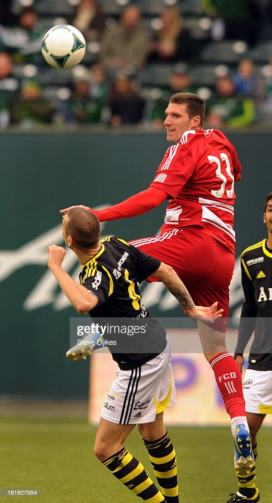 <a gi-track='captionPersonalityLinkClicked' href=/galleries/search?phrase=Kenny+Cooper&family=editorial&specificpeople=740251 ng-click='$event.stopPropagation()'>Kenny Cooper</a> #33 of FC Dallas goes up for a ball with Alexander Milosevic #6 of AIK during the second half of the game at Jeld-Wen Field on February 17, 2013 in Portland, Oregon. The game ended in a 0-0 draw.