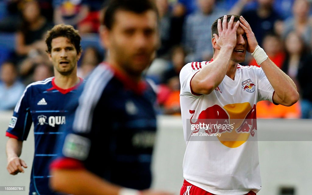 Kenny Cooper of New York Red Bulls reacts after missing a shot against the Chicago Fire during their match at Red Bull Arena on October 6 2012 in...