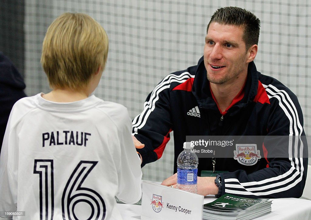 <a gi-track='captionPersonalityLinkClicked' href=/galleries/search?phrase=Kenny+Cooper&family=editorial&specificpeople=740251 ng-click='$event.stopPropagation()'>Kenny Cooper</a> of the New York Red Bulls signs autographs during Soccer Night In Newtown at Newtown Youth Academy Sports & Fitness Center on January 7, 2013 in Newtown, Connecticut.