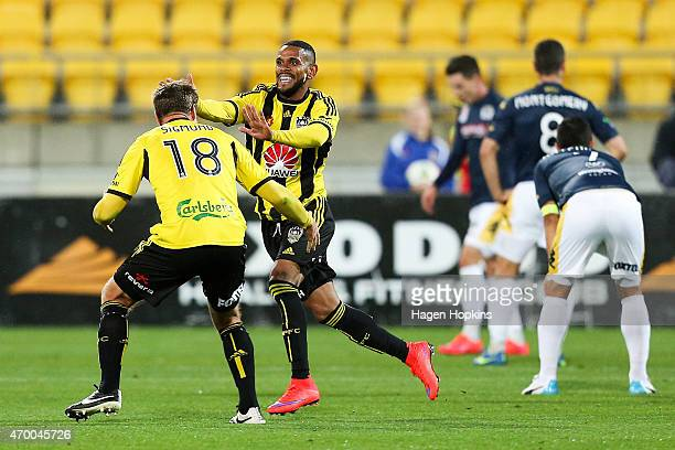 Kenny Cunningham of the Phoenix celebrates his goal with teammate Ben Sigmund during the round 26 ALeague match between the Wellington Phoenix and...
