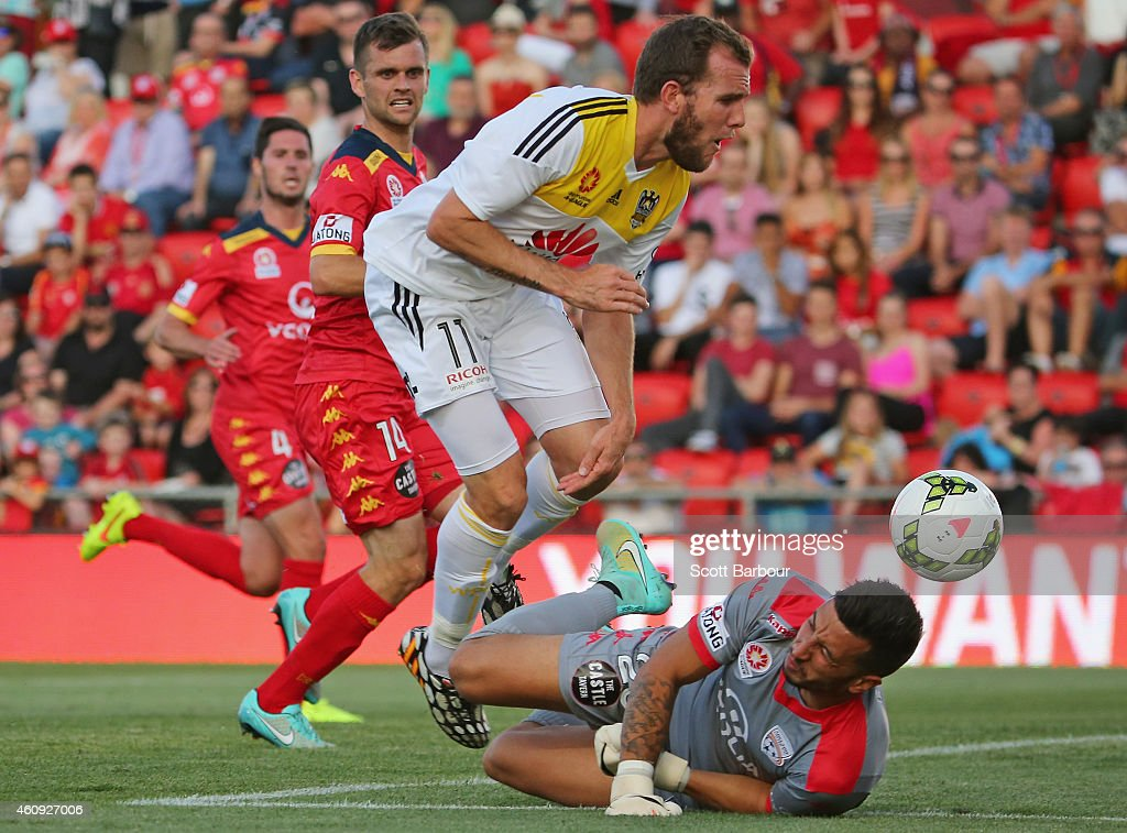 <a gi-track='captionPersonalityLinkClicked' href=/galleries/search?phrase=Kenny+Cunningham&family=editorial&specificpeople=217790 ng-click='$event.stopPropagation()'>Kenny Cunningham</a> of the Phoenix jumps over goalkeeper Paul Izzo of United as he makes a save during the round 14 A-League match between Adelaide United and Wellington Phoenix at Coopers Stadium on December 31, 2014 in Adelaide, Australia.