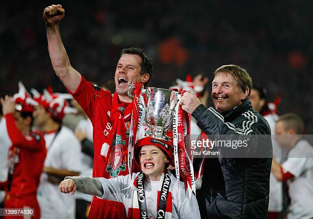 Kenny Dalglish manager of Liverpool and Jamie Carragher celebrate with the trophy after the Carling Cup Final match between Liverpool and Cardiff...