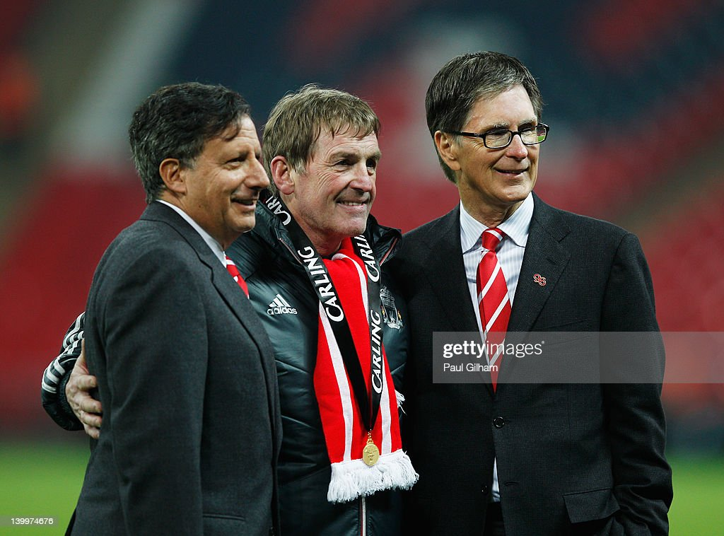 <a gi-track='captionPersonalityLinkClicked' href=/galleries/search?phrase=Kenny+Dalglish&family=editorial&specificpeople=221580 ng-click='$event.stopPropagation()'>Kenny Dalglish</a> manager of Liverpool celebrates with Liverpool owners Liverpool owner Tom Werner (L) and John W Henry (R) after victory in the Carling Cup Final match between Liverpool and Cardiff City at Wembley Stadium on February 26, 2012 in London, England. Liverpool won 3-2 on penalties.