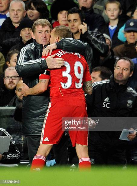 Kenny Dalglish manager of Liverpool hugs Craig Bellamy of Liverpool as he comes off during the Carling Cup quarter final between Chelsea and...