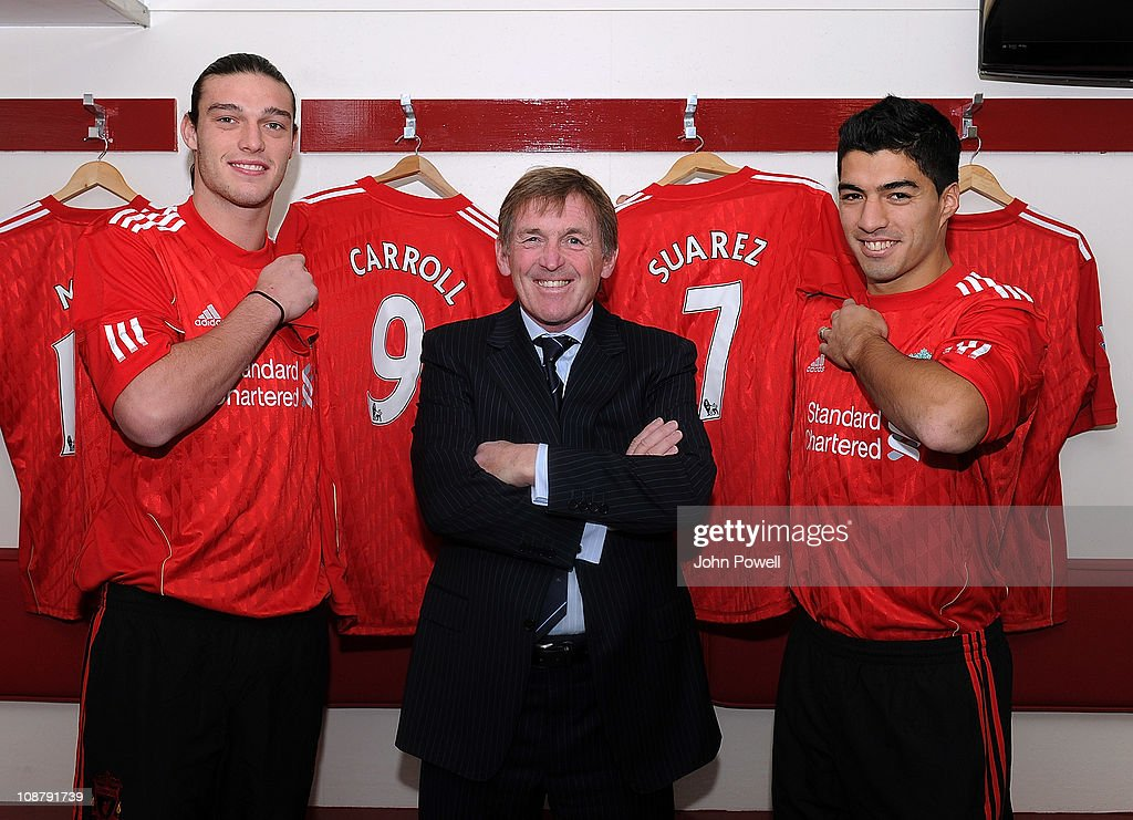 Kenny Dalglish manager of Liverpool poses with new signings Andy Carroll (L) and Luis Suarez (R) at Anfield on February 3, 2011 in Liverpool, England.