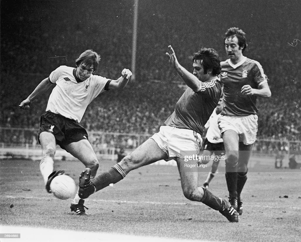 Kenny Dalglish of Liverpool has his shot blocked by Nottingham Forest's Larry Lloyd as Frank Clark looks on during the League Cup Final at Wembley...