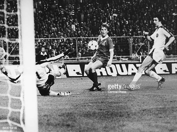 Kenny Dalglish of Liverpool watches apprehensively after chipping the ball past FC Bruges goalkeeper Birger Jensen in the European Cup final at...
