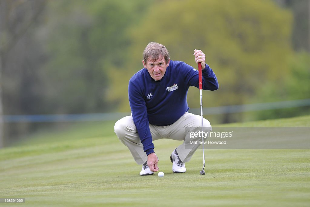 <a gi-track='captionPersonalityLinkClicked' href=/galleries/search?phrase=Kenny+Dalglish&family=editorial&specificpeople=221580 ng-click='$event.stopPropagation()'>Kenny Dalglish</a> prepares to putt at the Celebrity Golf Club Live event at Celtic Manor Resort on May 12, 2013 in Newport, Wales.