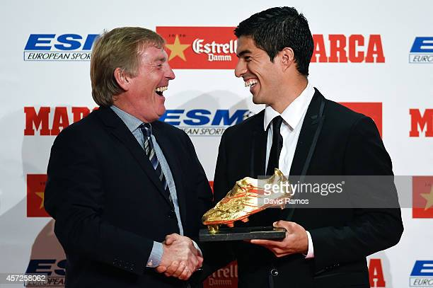 Kenny Dalglish shares a joke as he presents the Golden Boot Trophy to Luis Suarez as the best goal scorer in all European Leagues last season on...