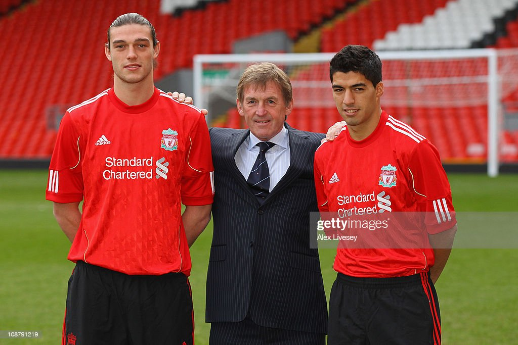 <a gi-track='captionPersonalityLinkClicked' href=/galleries/search?phrase=Kenny+Dalglish&family=editorial&specificpeople=221580 ng-click='$event.stopPropagation()'>Kenny Dalglish</a> the manager of Liverpool stands between his new signings, <a gi-track='captionPersonalityLinkClicked' href=/galleries/search?phrase=Andy+Carroll+-+Soccer+Player&family=editorial&specificpeople=1449090 ng-click='$event.stopPropagation()'>Andy Carroll</a> (l) and Luis Suarez (r) during a photocall at Anfield on February 3, 2011 in Liverpool, England.