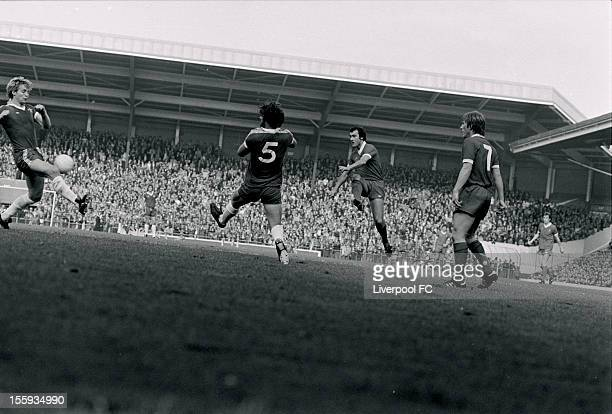 Kenny Dalglish watches Ray Kennedy of Liverpool power in a shot past Micky Droy and Steve Wicks of Chelsea during the league division one match...
