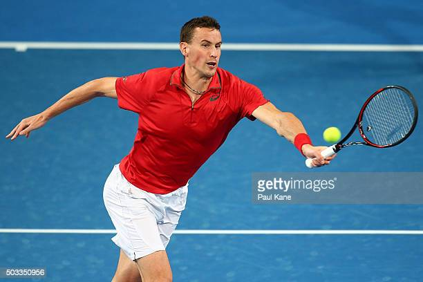 Kenny De Schepper of France plays a forehand in the mixed doubles match during day two of the 2016 Hopman Cup at Perth Arena on January 4 2016 in...