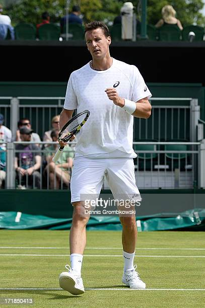Kenny de Schepper of France reacts during the Gentlemen's Singles third round match against Juan Monaco of Argentina on day six of the Wimbledon Lawn...