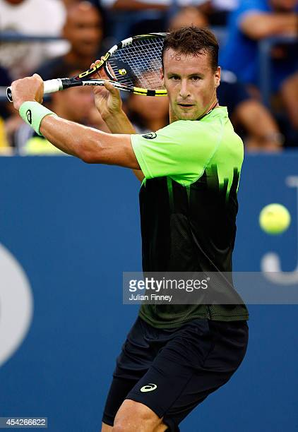 Kenny De Schepper of France returns a shot against Ernests Gulbis of Latvia on Day Three of the 2014 US Open at the USTA Billie Jean King National...
