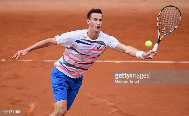 Kenny de Schepper of France returns a shot during his men's singles match against Tommy Robredo of Spain on day four of the French Open at Roland...
