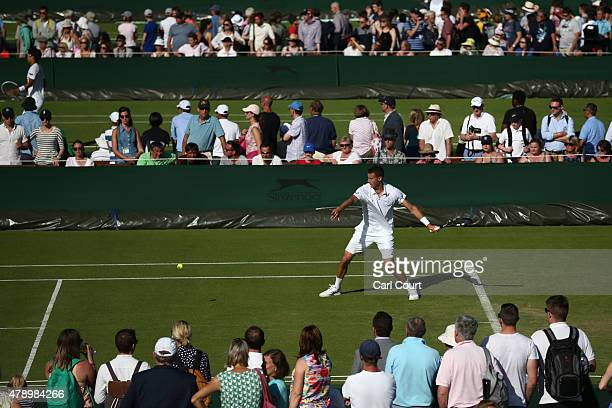 Kenny De Schepper of France returns against JohnPatrick Smith of Australia in their Gentleman's Singles first round match on day one of Wimbledon...
